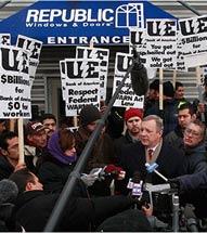 Protestors with signs at Republic Windows & Doors