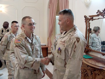 Donald Buswell shaking hands with soldiers