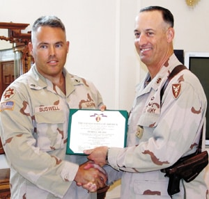 SFC DONALD BUSWELL receives Purple Heart for injuries sustained in Iraq