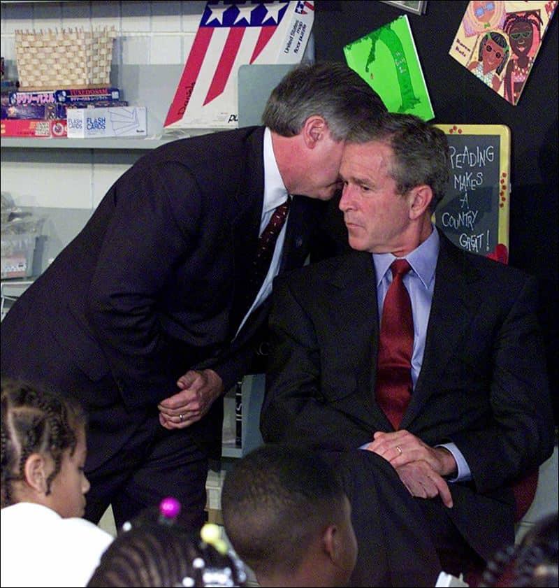 Andrew Card informing President Bush at Booker Elementary