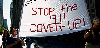 People holding a banner, Stop the 9-11 Cover-up