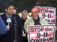 Press conference with signs that read, stop the 9-11 cover-up