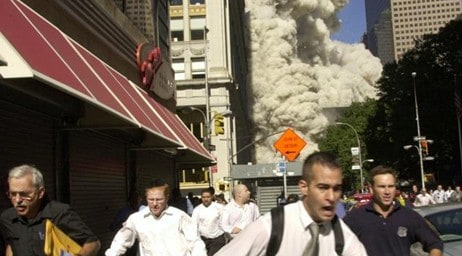 Photo of people running from the debris cloud on 911