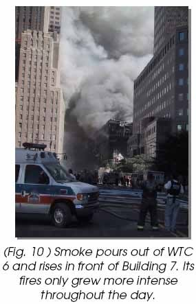 Smoke pours out of WTC 6 and rises in front of Building 7