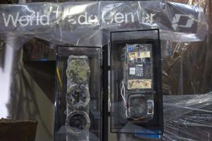 Image of damaged pay phone and traffic signal from Ground Zero