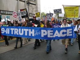 9/11 truth for peace banner held by marchers in large 9-11 demonstration