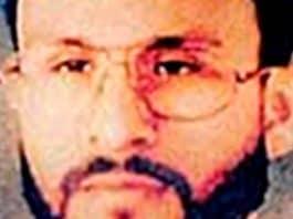 Abu Zubaydah appears wearing eyeglasses and clean, neat facial hair