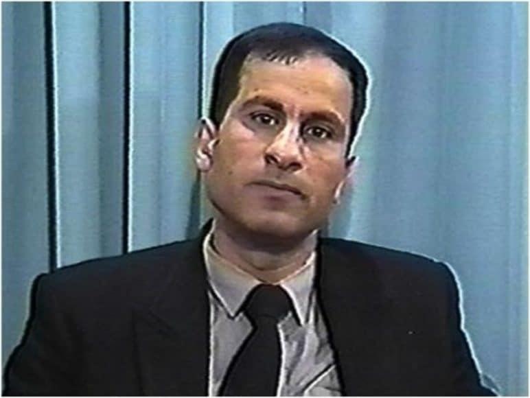Ali Mohamed against blue background