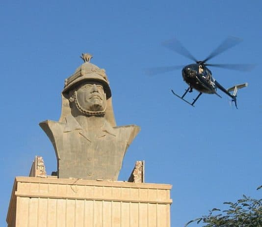 A Blackwater helicopter flies over Republican Palace in Baghdad