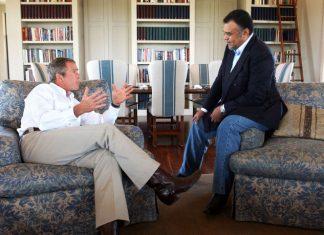 Saudi Prince Bandar, Saudi Ambassador, sits comfortable with President Bush in conversation