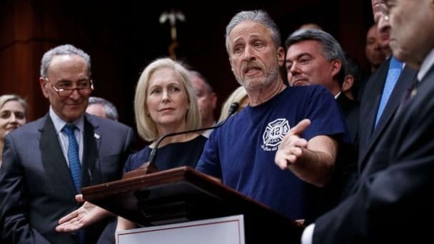 John Feal stands with senators Gillibrand, Maloney, Gardner, Schumer, and Nadler to get support for 1st responder health care bill