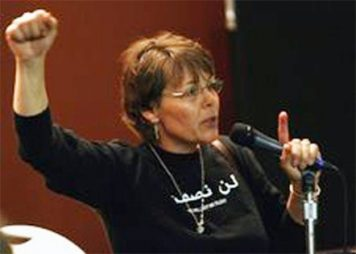 Janice speaking at a conference.