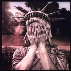 The statue of liberty holds her hands to cover her face in shame