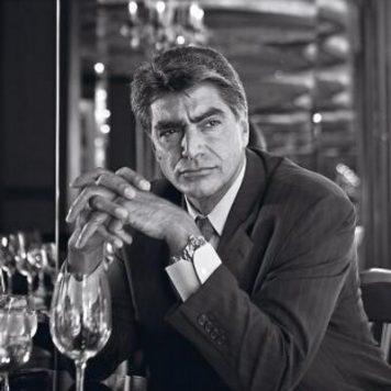MARK ROSSINI Former FBI Special Agent sitting at a bar