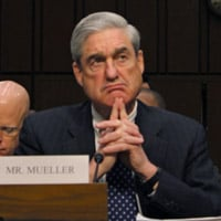 Former FBI Director Robert Mueller appears lost in thought during hearing
