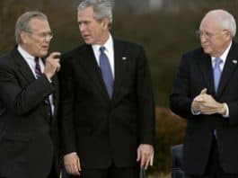 Photo of Rumsfeld, Bush and Cheney walking at the Bush ranch in Texas