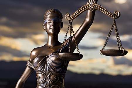 Image of blindfolded justice holding scales