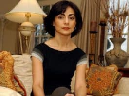 Sibel Edmonds sits in a well-appointed living room
