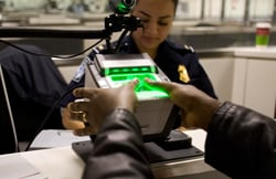 Photo of fingerprint scanning for traveler tracking