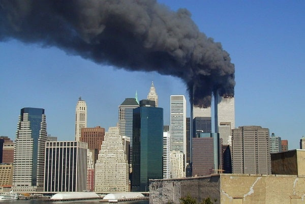 Thick black smoke rises from the WTC towers on 9/11