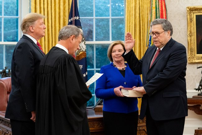 Attorney General William Barr takes oath of office at Swearing in ceremony by Justice Roberts at the White House with President Trump