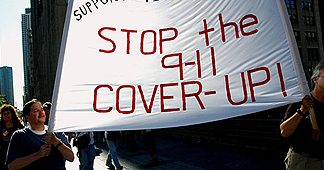 9-11 activists marching with a Stop the 9-11 Cover-Up banner