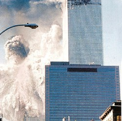 Image of disintegrating World Trade Center South Tower with Building 7 in foreground