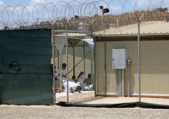 Image of detainees at Guantanamo Bay praying
