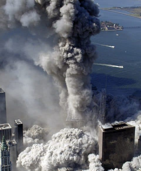 Gray smoke rises from the core columns still visible moments after the complete collapse of the South Tower of the WTC
