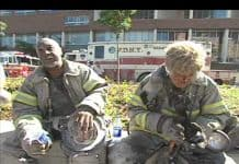 Photo of Firefighters covered in dust from the collapsed World Trade Center Towers