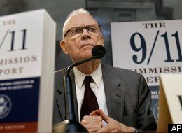 Lee Hamilton poses in front of large models of the 9-11 Commission Report