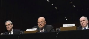 Photo of FBI Director Robert Mueller, Director of National Intelligence James Clapper and CIA Director John Brennan testify before the Senate Select Intelligence Committee in 2013