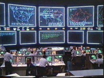 Image of a wall of screens at NORAD war room, Cheyenne Mountain