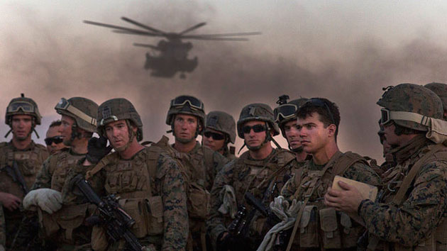 Photo of Marine Infantry Officer Course students stand by before a helicopter drill in Arizona.