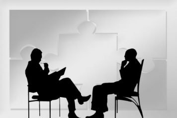 Silhouette of two people conversing, working through the problem of self-deception