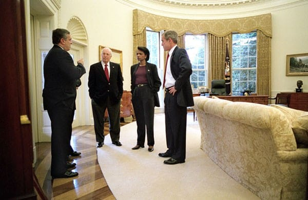 Photo of head of the spymasters CIA Director George Tenet speaking with Condi Rice, George Bush and Dick Cheney in Oval Office